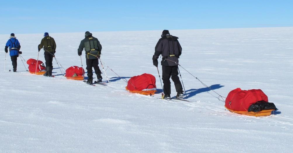 Line of sledgers near South Pole